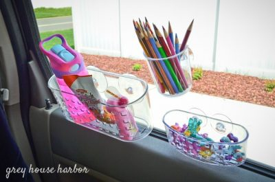 Attach sink caddies to your car windows for road trips. Fill it with snacks, coloring pencils and other items to keep your little one occupied while in the backseat.