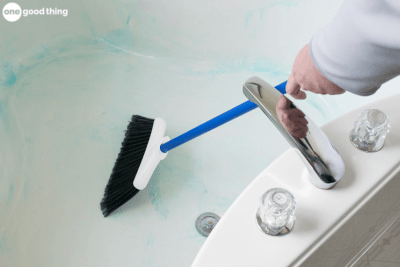 Prevent back pain by using a broom to clean your bathtub.