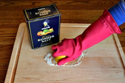Lemon and salt work together to disinfect your cleaning boards.