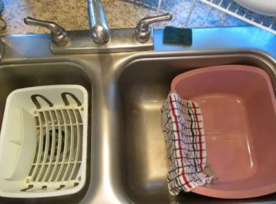 Wash dishes in a bin to save water.