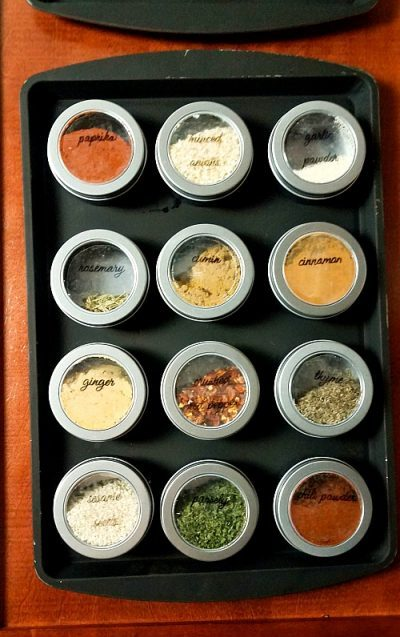 Make a magnetic spice rack with dollar store tin canisters.