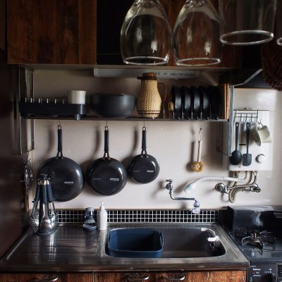 Hang your favorite post and pans on your kitchen back splash to save space.