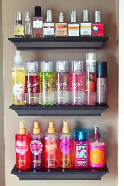 Use simple shelves to display and organize your favorite perfumes and lotions.