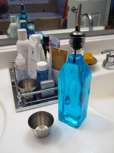 You can store your mouthwash in an olive oil bottle to make your bathroom counter look neat and organized.