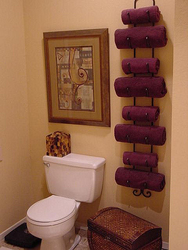 Use a wine rack to store and organize bathroom towels.