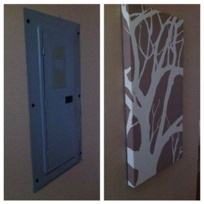 Cover unsightly electrical boxes with cheap canvas art or wall decor.