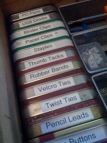 Reuse Altoid canisters to store small items while on a road trip.
