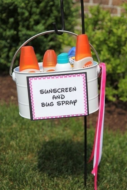 Sunscreen and bug spray station for a summer party.