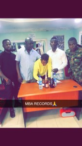 Starboy Fizzy signing his Deal