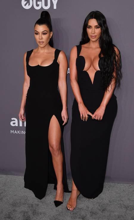 Kourtney and Kim Kardashian stole the scene at the amfAR ball Photo: ANGELA WEISS / AFP