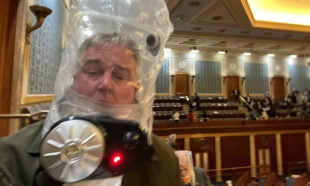 Rep. David Trone wears a gas mask inside the Capitol Photo: TWITTER/@REPDAVID TRONE / via REUTERS