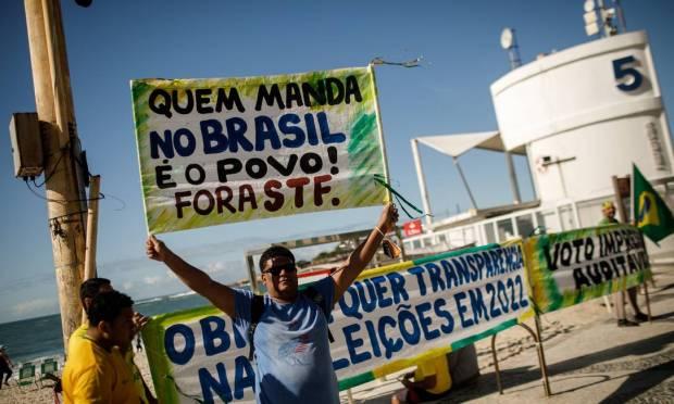 In the photo, a protester participates in a pro-Bolsonaro act, in Copacabana 01/08/2021 Photo: Brenno Carvalho / Agência O Globo