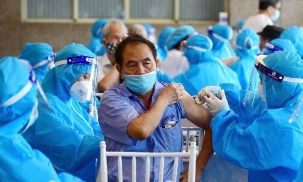 Man receives Covid-19 vaccine in Hanoi, Vietnam Photo: NHAC NGUYEN / AFP