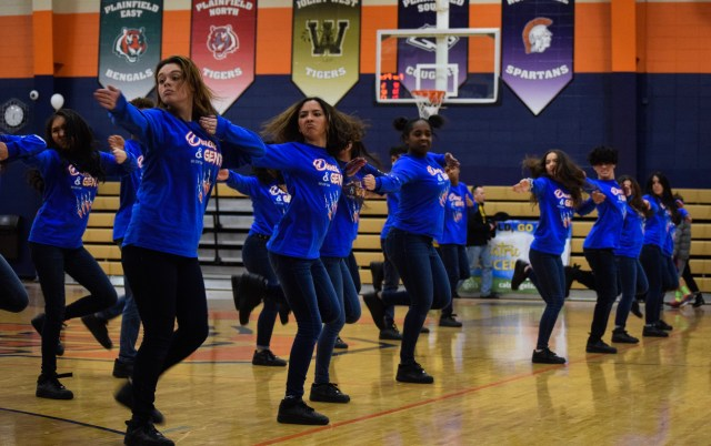 The Oswego High School Step Team performs at half time.