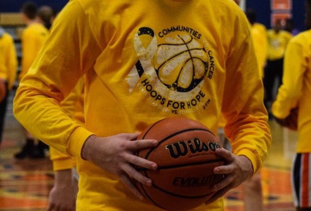 Hoops for Hope T-Shirt. Text: Communities Vs. Cancer. Hoops for Hope. Oswego Panthers vs. Yorkville Foxes. 2019.