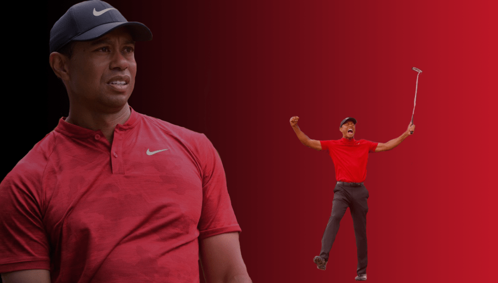 Tiger Woods celebrating with his arms up