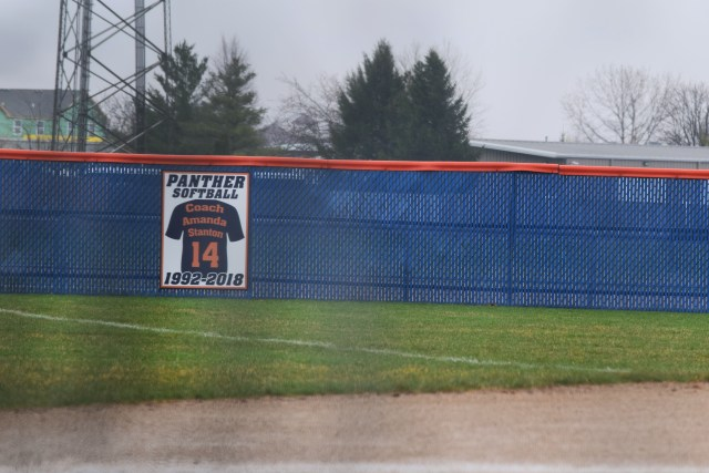 "The sign posted in the outfield. Text: ""Coach Amanda Stanton, 14, 1992-2018"""