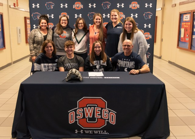 Senior Kela Jagoda signs to Case Western Reserve University and is surrounded by family and coaches