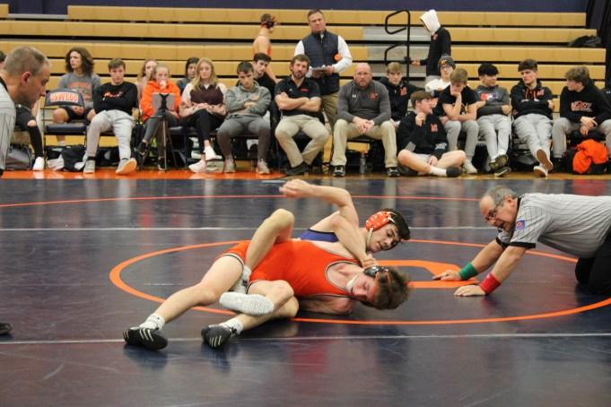 Zach Sato taking down an opponet.