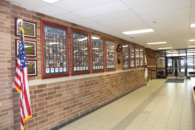 The Wall of Honor in the main hall of Oswego High School displays alumni who have gone on to serve in the military after their graduation from the school.