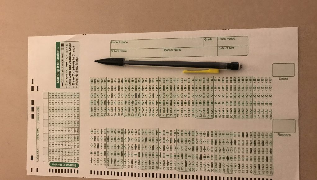 A scantron testing sheet and pencil