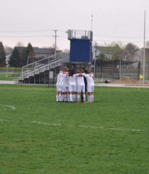 The Panthers gather at midfield before a match against Oswego East.