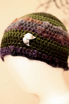 crochet cloche made with red heart magical yarn with silver leaf embellishments