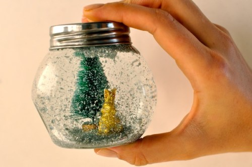 Glitter Globe by Camille Styles - 30 Incredible Dollar Store DIY Christmas Decor Ideas. Easy to make decorations that you can do on a small budget. Make beautiful and easy centrepieces, ornaments, candle holders and mason jar crafts. These awesome Dollar Tree DIY Christmas crafts are simple enough to be made with your kids. Just click on this to find out more or pin for later!