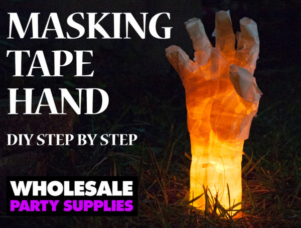 Masking Tape Hand - The Best DIY Halloween decorations for outdoor and yard to turn your porch into a haunted house. How to make graveyards, spider webs, chicken wire ghosts and other awesome and scary. These are so easy to make even kids can do them.