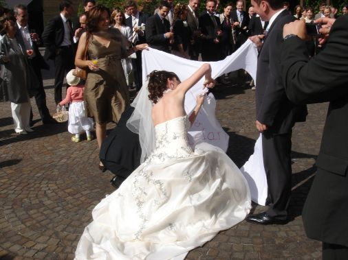 german-wedding-tradition-cutting-heart-from-sheet
