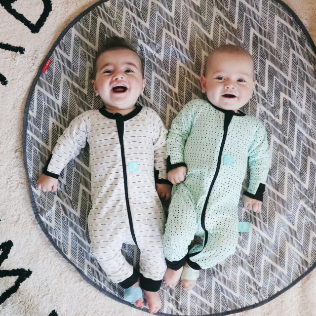 Twins on play mat