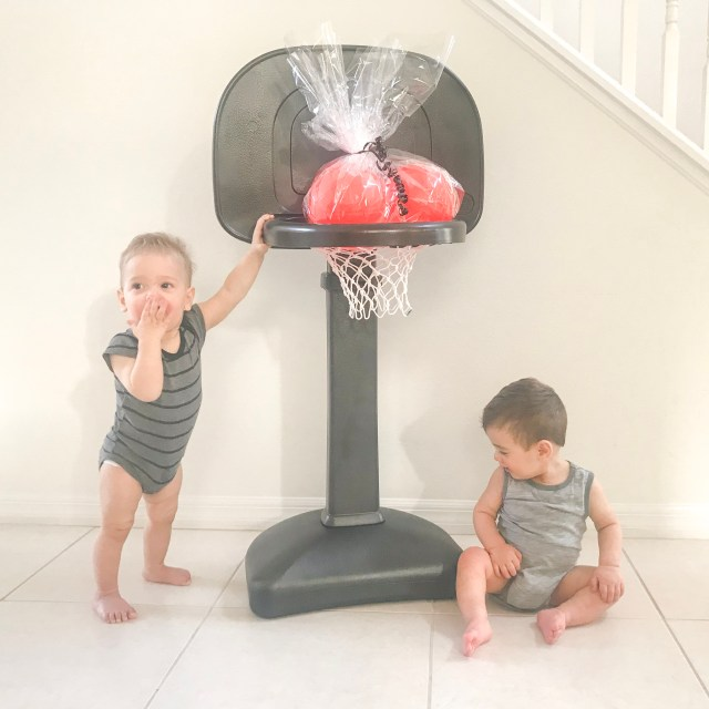 Want to create a monochrome nursery? A big bright basketball hoop may not be the right aesthetic. Check out this DIY Painted Plastic Basketball Hoop for Toddlers!