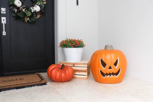 Fall flowers, light up jack-o-lantern, patio ideas