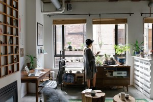 woman walking in her home business office