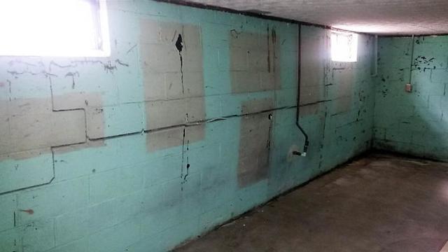 Blue paint emphasizes severe foundation failure.
