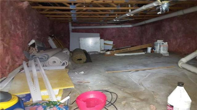 This crawl space is not safe or healthy storage area.