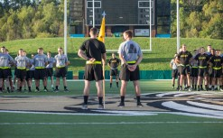 Cadets in Ohio's Bobcat Battalion stand on the football field at Peden Stadium during the opening ceremony of the second annual 9/11 Stair Challenge Event on Sept. 11, 2016.