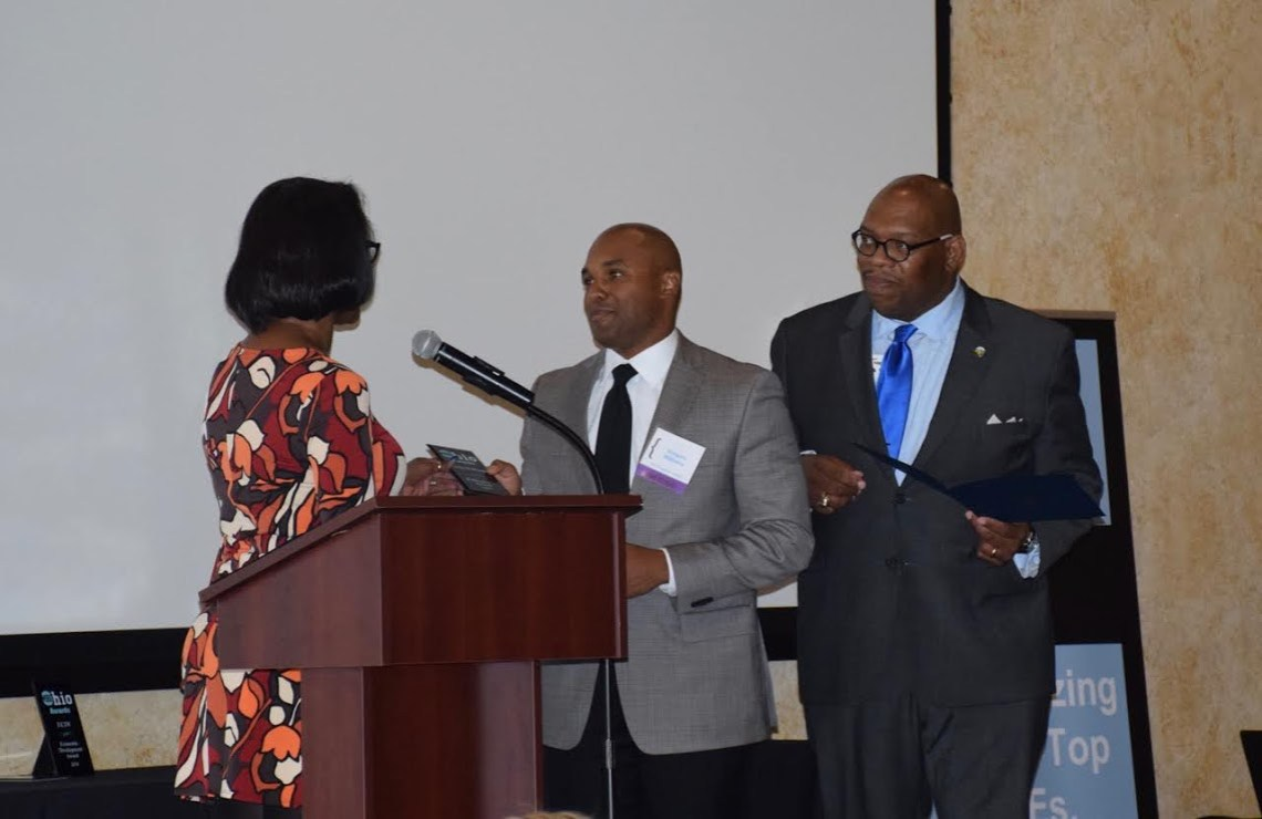 Attorney Greg Williams receives the Publisher's Award.
