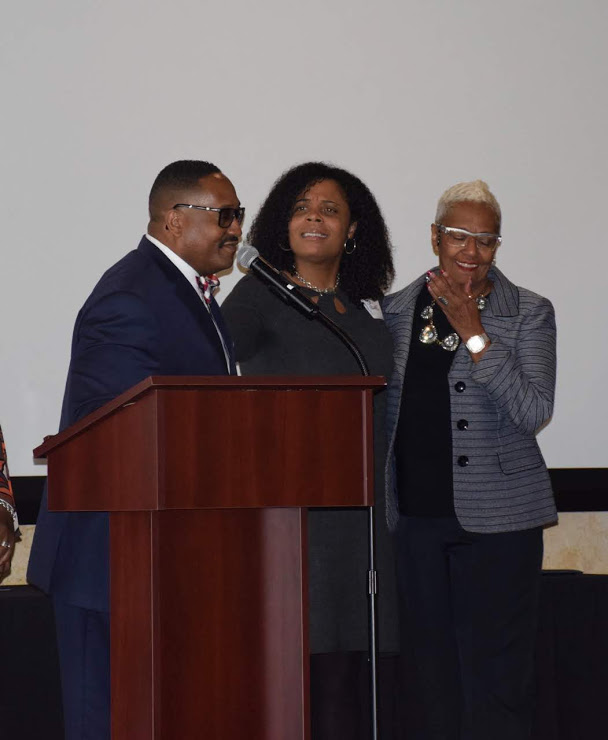 Rev. John Coates & Joy Bivens present the Civil Rights Award to Nana Watson.