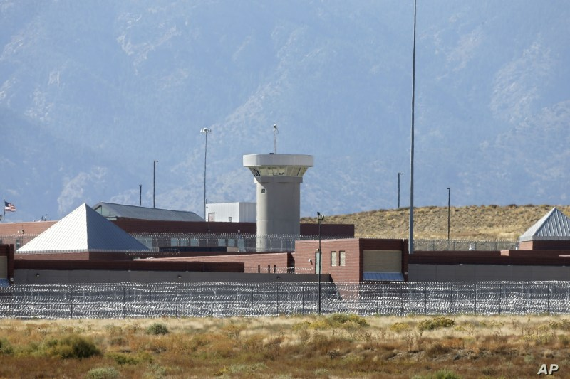 FILE - This Thursday, Oct. 15, 2015 file photo shows a guard tower looming over a federal prison complex which houses a Supermax facility outside Florence, in southern Colorado. The prison is among those being assessed by a team of Pentagon…