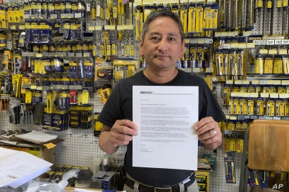 In this photo taken Wednesday, Aug. 28, 2019, Albert Chow, owner of Great Wall Hardware in San Francisco, holds a May 2019 letter from a supplier notifying him that prices will be increasing 10 to 18 percent because of US tariffs on Chinese goods…