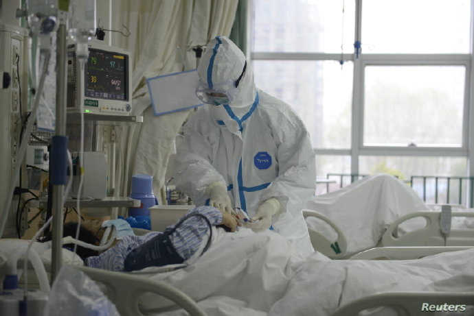 A picture released by the Central Hospital of Wuhan shows medical staff attending to patient at the The Central Hospital Of Wuhan Via Weibo in Wuhan, China on an unknown date.