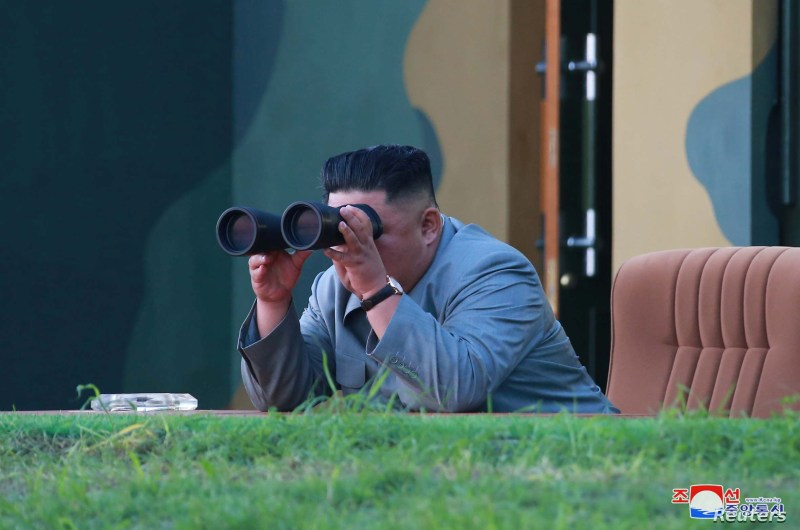 North Korean leader Kim Jong Un watches the test-fire of two short-range ballistic missiles Thursday, in this undated picture released by North Korea's Central News Agency, July 26, 2019.