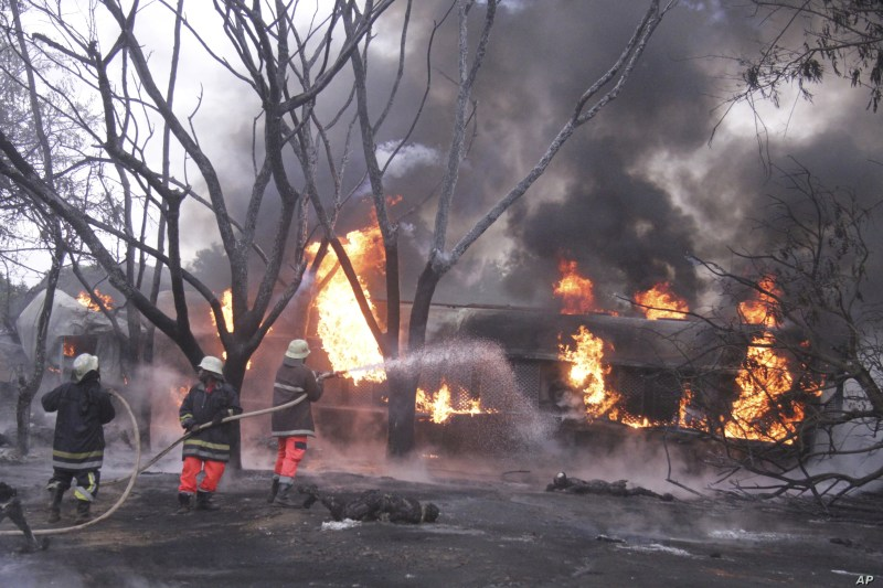 CORRECTING TO PETROL TANKER - Fire fighters try to extinguish a Petrol Tanker blaze, Saturday, Aug. 10 2019, in Morogoro, Tanzania.   A damaged tanker truck exploded in eastern Tanzania Saturday as people were trying to siphon fuel out of it,…