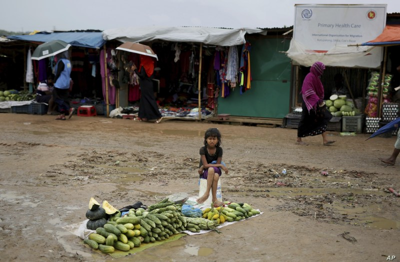 A Rohingya refugee girl sells vegetables in Kutupalong refugee camp, Bangladesh, Aug. 28, 2018.