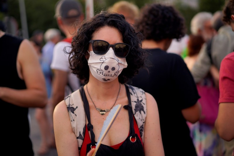 A woman takes part in a protest against Madrid's new conservative People's Party (PP) municipal government plans to suspend some anti-car emissions policies in the city center