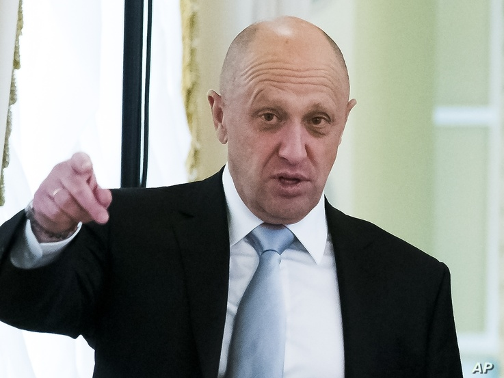 FILE - Kremlin-linked businessman Yevgeny Prigozhin gestures on the sidelines of a meeting at the Konstantin palace outside St. Petersburg, Russia, Aug. 9, 2016.