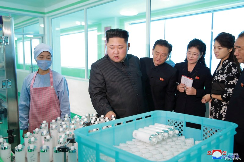 FILE - North Korean leader Kim Jong Un and wife Ri Sol Ju visit a cosmetics factory in this undated photo released by North Korea's Korean Central News Agency in Pyongyang, Oct. 28, 2017.