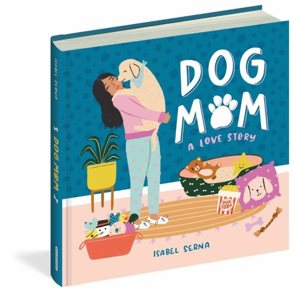 The cover of Dog Mom features a woman holding her puppy surrounded by dog gear like toys, a bed, and decor.