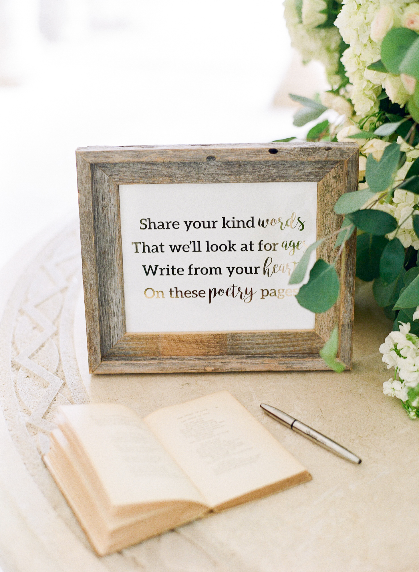 Photo of book and note for guests to write messages as they enter.